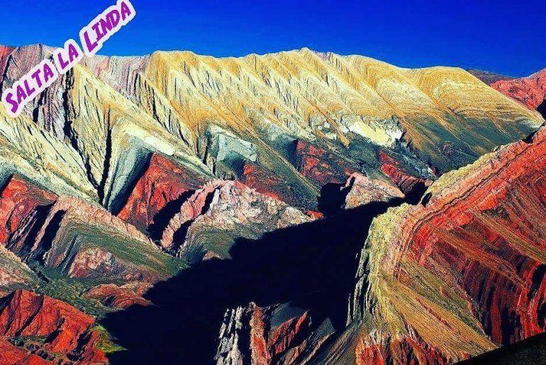 Otra agencia de turismo promociona Salta la linda con una foto de las Serranías del Hornocal