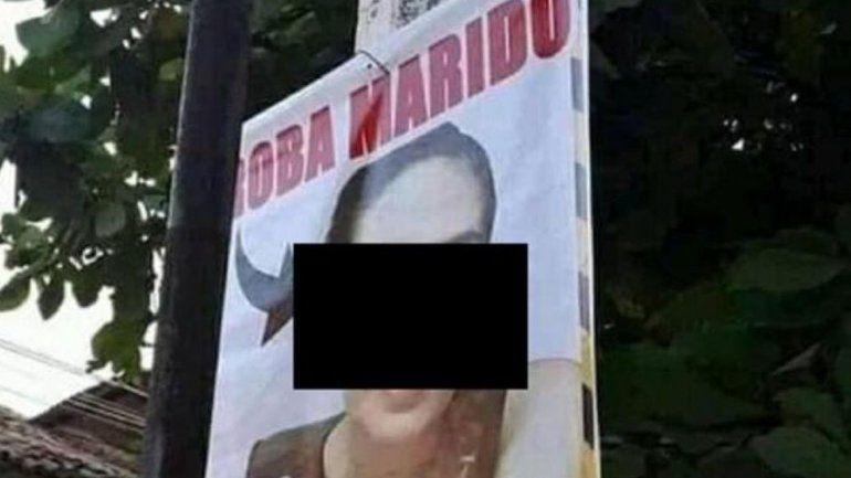 Escracharon a una roba maridos con una amenaza en un banner